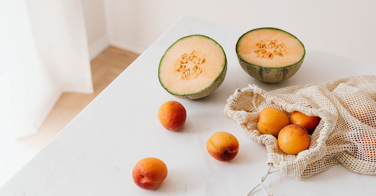 A melon and a plate of food on a table