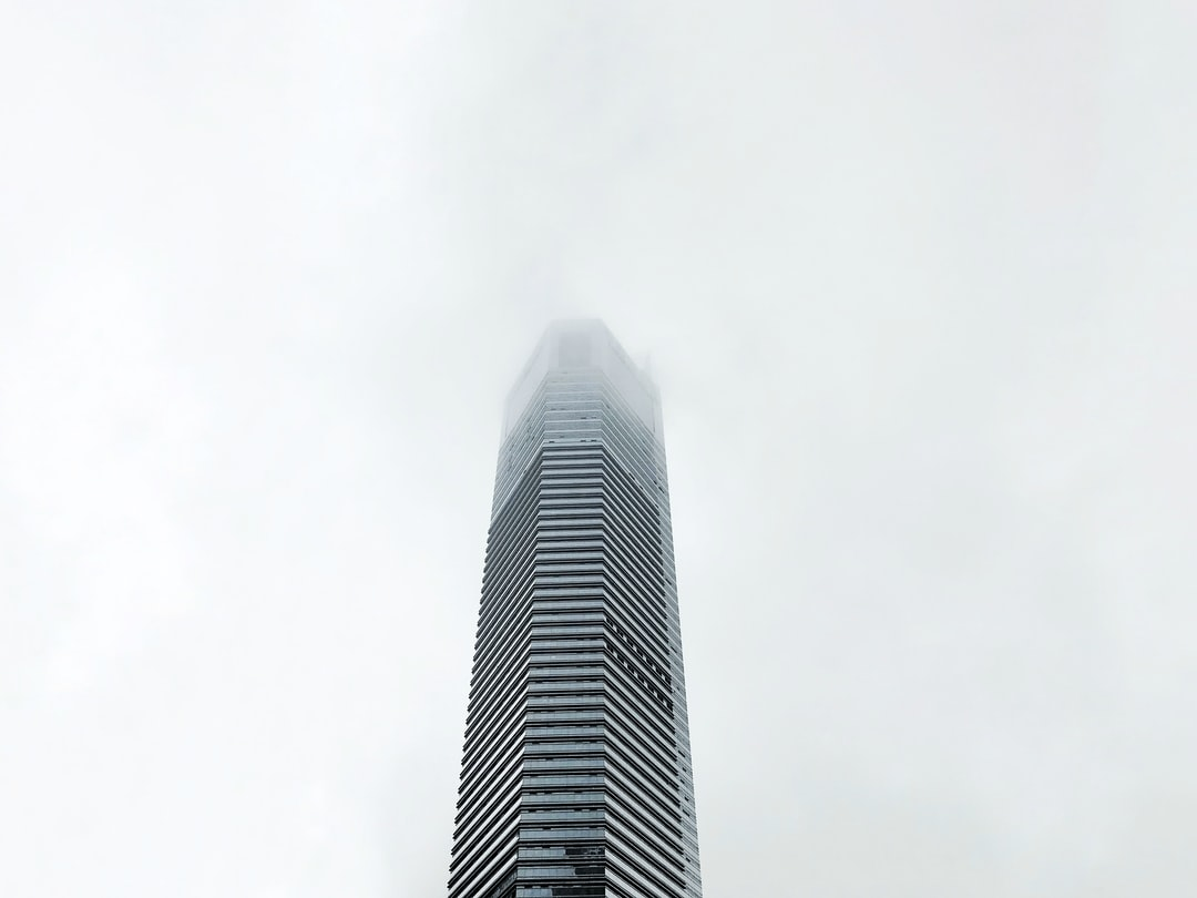 A large tall tower with a sky background