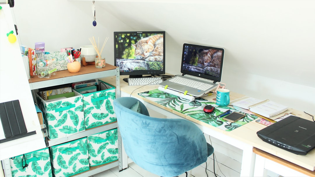 A desk with a laptop in a living room